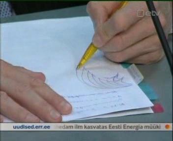rahandusminister jürgen ligi joonistab langevaid kaarekesi 29. aprill 2010 ETV uudiste kaader