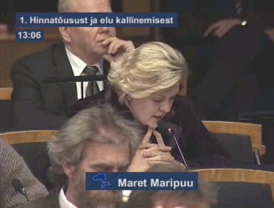 Maret Maripuu Reformierakonnast küsib oma erakonna kaaslaselt Andrus Ansipilt majanduskriisi tekitamise kohta. Kaader Riigikogu ülekandest.