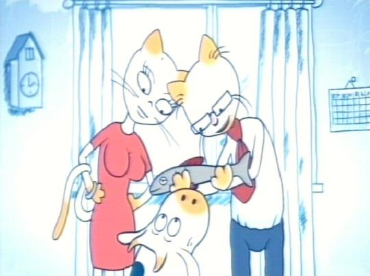 Televisioon näitab perekonda, mis koosneb kassiemast, kassiisast ja lehmavasikast. Pöörake tähelepanu ka punase kleidi joontele.
